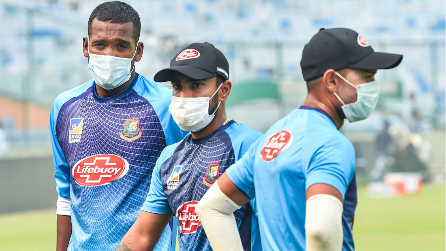 Al-Amin Hossain, Liton Das and Abu Hider wearing face masks during a practice session
