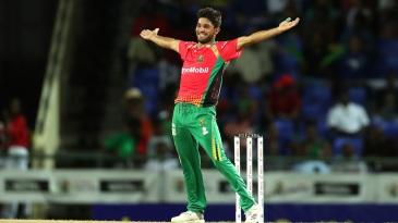 Qais Ahmad celebrates a wicket for Guyana Amazon Warriors