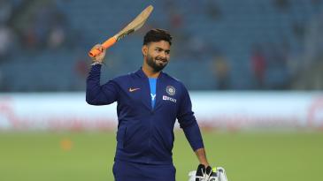 A bat- and gloves-wielding Rishabh Pant wears a grin