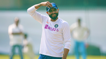 Ravindra Jadeja has a laugh during a practice session