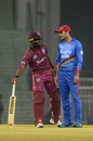 Evin Lewis and Mohammad Nabi have a chat, Afghanistan v West Indies, 1st T20I, Lucknow, November 14, 2019