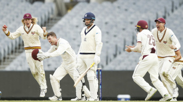 Queensland celebrate Jon Holland's wicket which sealed the win