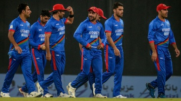 The Afghanistan walk off the field after the end of their bowling effort