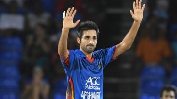 Karim Janat celebrates a wicket
