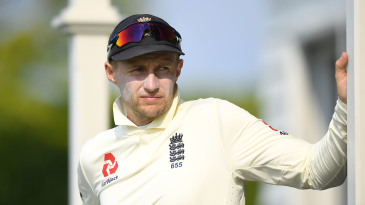 Joe Root watches from the dressing rooms during day three of the tour match between New Zealand A and England