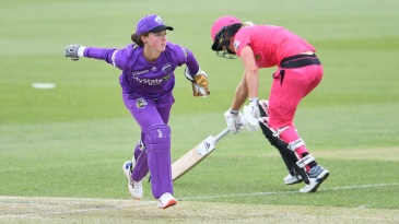 Wicketkeeper Emily Smith in action