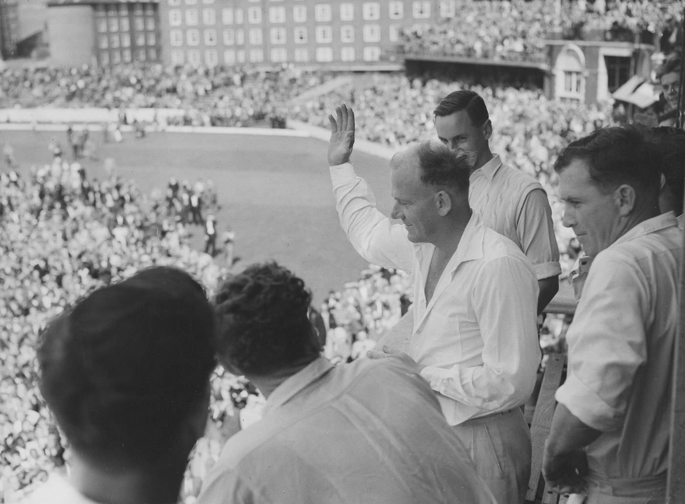 Tony Lock greets the fans after his 6 for 20 shot West Indies out for 86 at The Oval in 1957