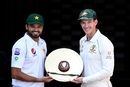 Azhar Ali and Tim Paine pose with the trophy, Brisbane, November 20, 2019