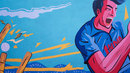 The final scene in a series of murals that depict a boy's journey from the <i>maidan</i> to the Indian team