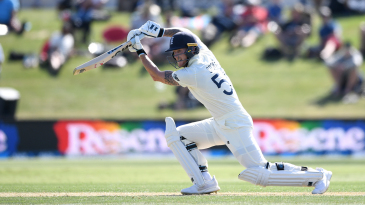 Ben Stokes gets forward to drive