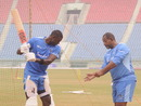 Jason Holder discusses his batting with coach Phil Simmons, Lucknow, November 26, 2019