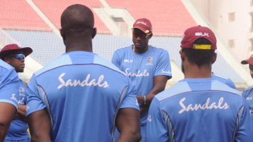 Jason Holder gives a talk to his team-mates