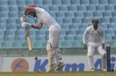 Afsar Zazai plays a defensive stroke, Afghanistan v West Indies, Only Test, 1st day, Lucknow, November 27, 2019