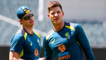 Tim Paine with Steven Smith at training