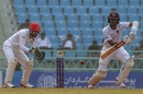 Kraigg Brathwaite plays one on the off side as Afsar Zazai looks on, Afghanistan v West Indies, only Test, Lucknow, 1st day, November 27, 2019