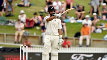 Daryl Mitchell acknowledges the applause after bringing up his fifty on Test debut