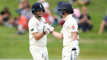 Joe Root is congratulated by Ollie Pope after bringing up his 150
