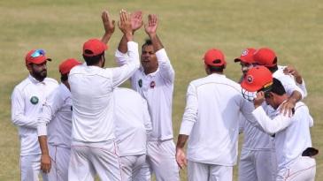 Nauman Ali celebrates a wicket with his teammates