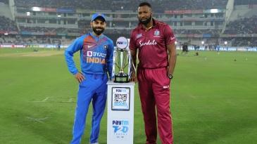 Kieron Pollard and Virat Kohli pose with the series trophy