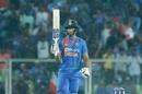 Shivam Dube raises his bat after smashing a maiden international fifty, India v West Indies, 2nd T20I, Thiruvananthapuram, December 8, 2019