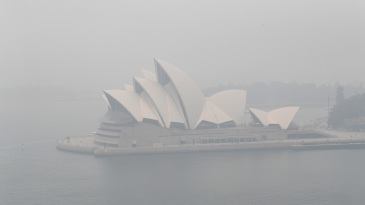 A smoke haze envelops the Sydney Harbour with the Opera House hardly visible