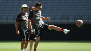 Trent Boult plays football at a training session