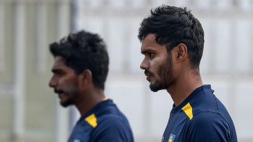 Dhananjaya de Silva and Lakshan Sandakan prepare to bowl at the nets