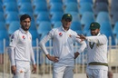 Azhar Ali discusses the field with Shaheen Shah Afridi and Usman Shinwari, Pakistan v Sri Lanka, 1st Test, Rawalpindi, Day 1