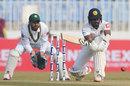 Oshada Fernando gets down for a paddle sweep, Pakistan v Sri Lanka, 1st Test, Rawalpindi, Day 1