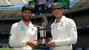 Kane Williamson and Tim Paine pose with the trophy