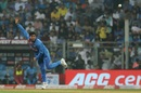 Kuldeep Yadav completes his action, India v West Indies, 3rd T20I, Mumbai, December 11, 2019