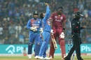 Kuldeep Yadav and Rishabh Pant celebrate Jason Holder's wicket, India v West Indies, 3rd T20I, Mumbai, December 11, 2019