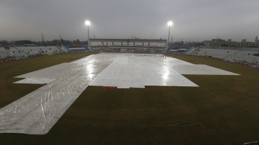 The ground staff keep the pitch and adjacent areas under cover due to rain
