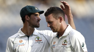 Mitchell Starc commiserates with Josh Hazlewood after the latter's injury