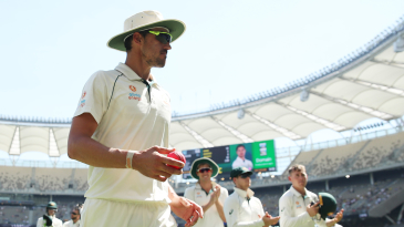 Mitchell Starc is applauded off the field by his team-mates after his 13th five-for in Test cricket