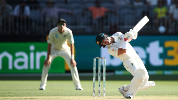 David Warner sways out of the way of a bouncer