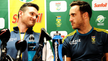 Graeme Smith and Faf du Plessis talk to each other at a press conference