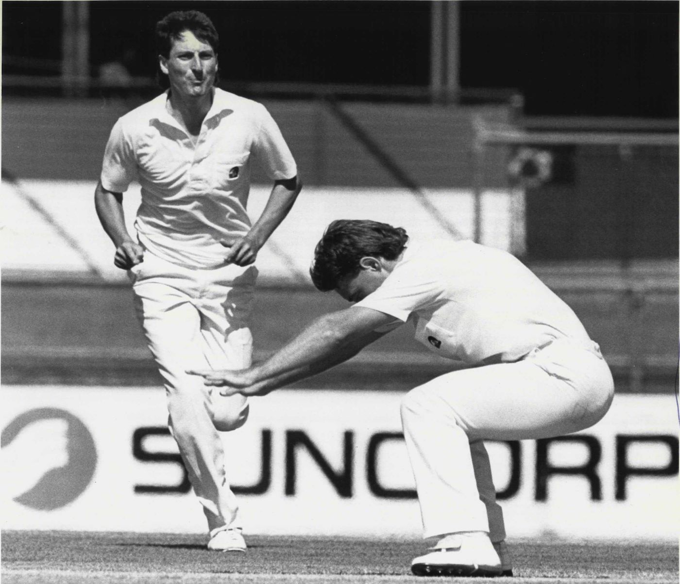 Danny Morrison bows to Allan Border (not in photo) after dismissing him in the Gabba Test earlier in the series