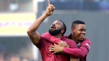 Kieron Pollard and Shimron Hetmyer celebrate Virat Kohli's dismissal