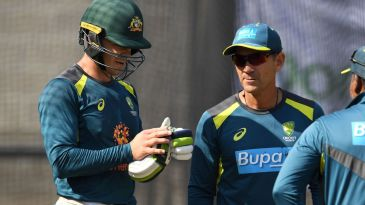 Tim Paine and Justin Langer have a chat in the nets