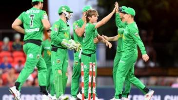 Adam Zampa celebrates a wicket with his team-mates