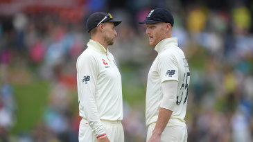 Joe Root and Ben Stokes consult in the field