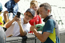 Peter Siddle poses with a fan after retiring from international cricket