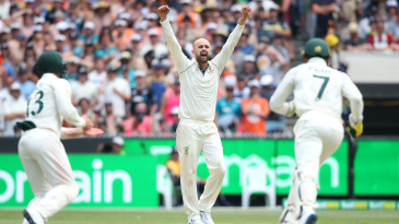 Nathan Lyon celebrates the wicket of BJ Watling
