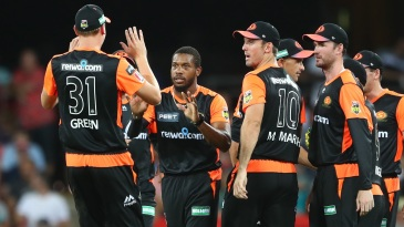 Chris Jordan surrounded by his Scorchers team-mates after taking a wicket