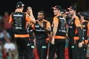 Chris Jordan surrounded by his Scorchers team-mates after taking a wicket, Brisbane Heat v Perth Scorchers, BBL, Carrara, January 1, 2020