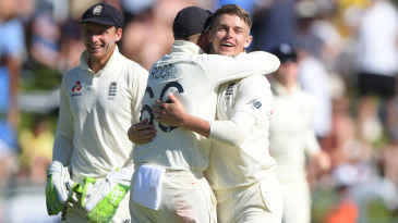 Sam Curran gets a hug from his captain