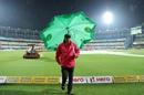 Umpire Nitin Menon jogs off the park as rain delays play,India v Sri Lanka, 1st T20I, Guwahati, January 5, 2020
