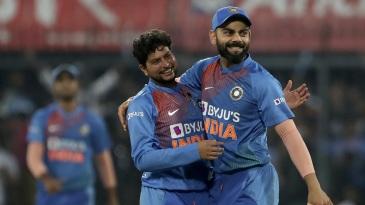 Virat Kohli congratulates Kuldeep Yadav for the wicket of the dangerous Kusal Perera