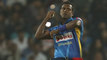 Angelo Mathews looks to roll his fingers over the ball